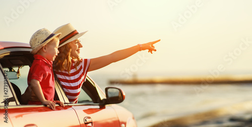 Vászonkép happy family mother and child boy goes to summer travel trip in car