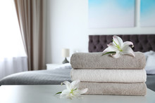 Stack Of Fresh Towels With Flo...