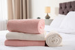 canvas print picture Folded and rolled soft towels on bed in room. Space for text