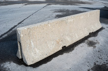 Concrete Barrier On Dirty Asph...