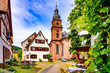 canvas print picture - Narrow street with view of the church in the old town of Amorbach in Lower Franconia, Bavaria, Germany