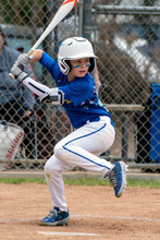 Youth Baseball Player In Blue ...