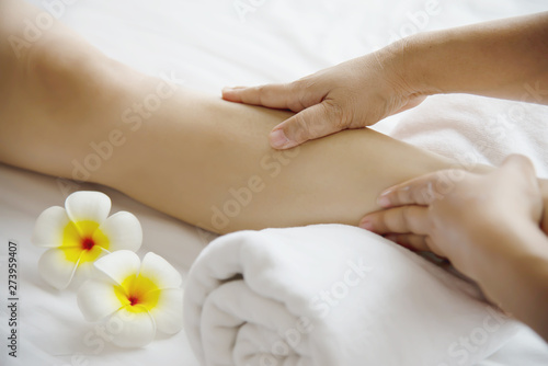 Poster Pedicure Woman receiving foot massage service from masseuse close up at hand and foot - relax in foot massage therapy service concept