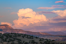 Sunset Paints Cumulus Clouds A...