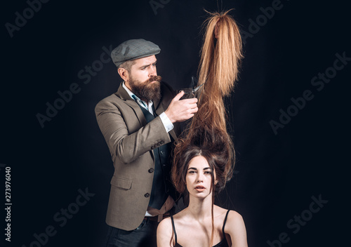 Female client getting haircut by hairdresser. Woman visiting hairstylist in hair salon. Beauty Model girl with Healthy Hair.