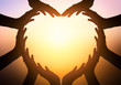 canvas print picture - International Day of Friendship concept: hands in shape of heart on blurred  background