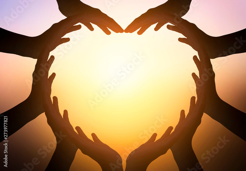 International Day of Friendship concept: hands in shape of heart on blurred  bac Wallpaper Mural