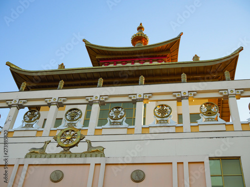 fragment of a Buddhist temple on the background of a blue neba at sunset Canvas Print