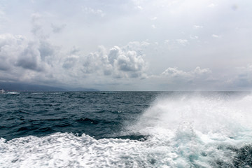 Waves, foam and sky from boat