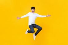 Young Happy Korean Teen Jumpin...