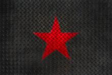 Red Star On Grunge Metal Diamond Plate Floor Texture.