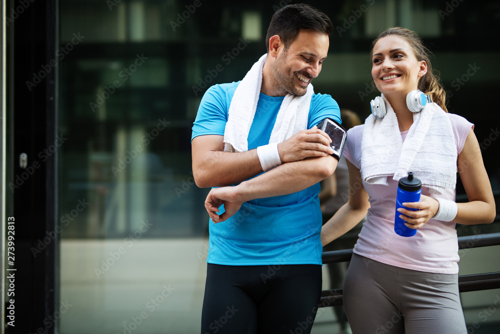 Fototapety, obrazy: Sporty happy couple exercising together. Sport concept