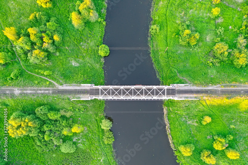 Foto auf AluDibond Pistazie Railway bridge among green meadows over a small river in the countryside, aerial view.