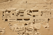 Ancient Egyptian Hieroglyphs And Symbols Carved In Stone, Preserved Fragments In Complex Of The Karnak Temple
