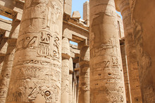 Ancient Egyptian Hieroglyphs And Symbols Carved On Columns Of The Complex Of The Karnak Temple