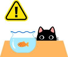 金魚を見ている猫と危...