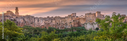 PITIGLIANO, TUSCANY, ITALY - JUNE 15, 2019 - View of Pitigliano town at sunset. Picturesque and unusual - built on tuff, tufaceous volcanic rock. - 274000488