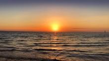 Intense Red Sunset At Beach