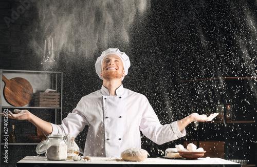 Male chef making dough in kitchen Slika na platnu