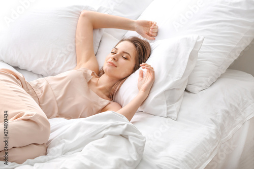 Fototapeta  Beautiful young woman sleeping in bed