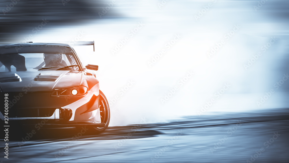 Fototapeta Car drifting, Blurred of image diffusion race drift car with lots of smoke from burning tires on speed track