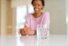 Beautiful Young African American Woman Drinking A Glass Of Fresh Water