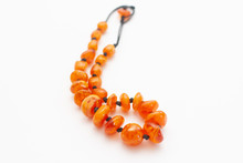 Amber Beads On White Background
