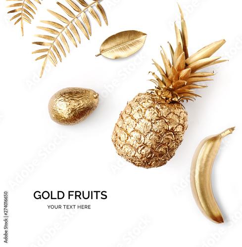 Creative layout made of gold pineapple, gold avocado, gold banana.  Tropical flat lay. Food concept. - 274016650