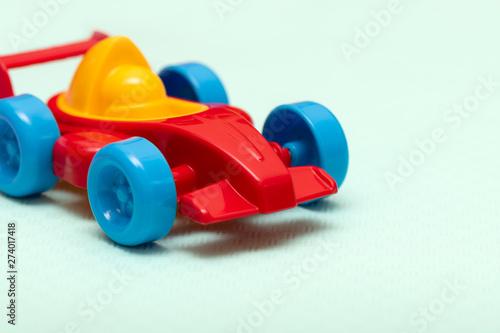 Children's toy plastic red machine, close up.