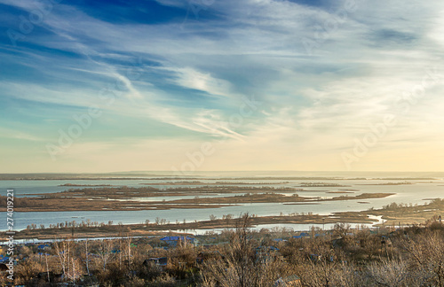 Foto auf Gartenposter Strand Volga river in late autumn, riverbed, spills and islands covered with trees without leaves,