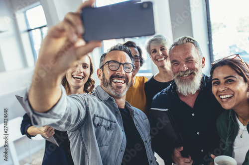 Multiracial group of people taking selfie at office Canvas Print