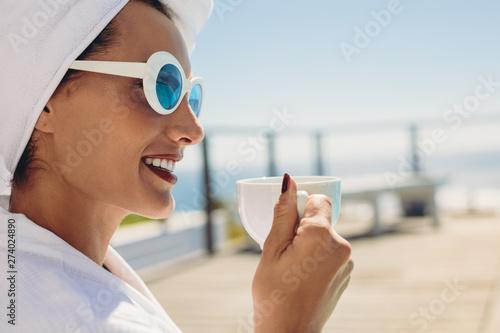 Woman in bathrobe having coffee - 274024890