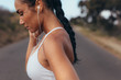 canvas print picture Fitness woman taking a breather after a run