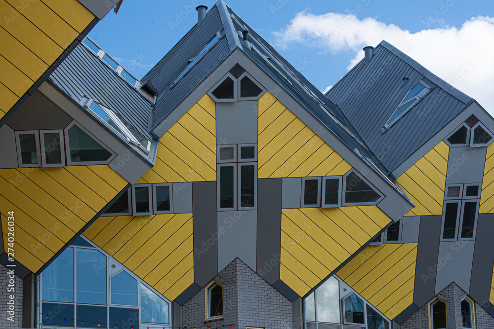 Fototapeta Rotterdam, Holland / Netherlands - April 26 2019: apartments and offices inside the cubic houses of Rotterdam, metropolitan city by architect Piet Blom