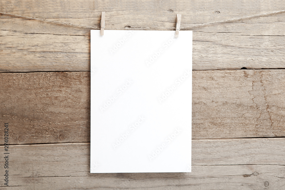 Fototapety, obrazy: A4 mock up - empty sheet of paper on a wooden background - blank A4 sheet on clothespins