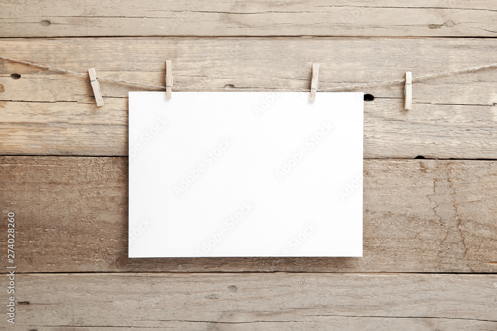 Fototapety, obrazy: A4 mock up - A4 paper on a wooden background - blank A4 sheet on clothespins