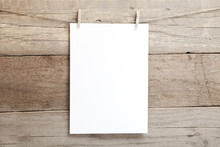 A4 Mock Up - Empty Sheet Of Paper On A Wooden Background - Blank A4 Sheet On Clothespins