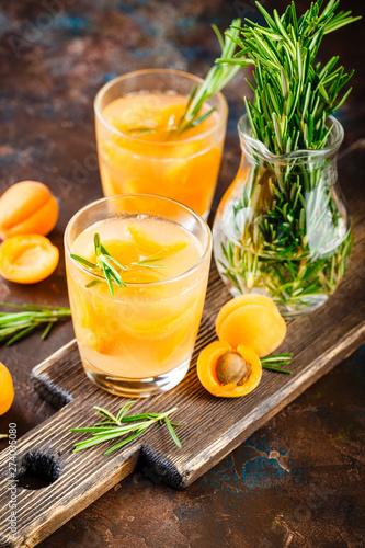 Fototapeta  Summer drinks, rosemary aprcot cocktails.