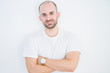 Leinwanddruck Bild - Young bald man over white isolated background happy face smiling with crossed arms looking at the camera. Positive person.