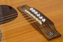 Acoustic Guitar Detail - Bridge, Saddle And Pins - Above Top