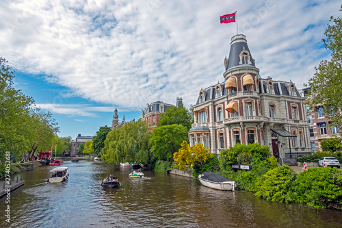 Amsterdam, Netherlands - May 16, 2019: Dutch house with the Amsterdam flag honor Wallpaper Mural