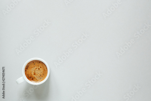 morning cup of coffee on light background, top view, copy space