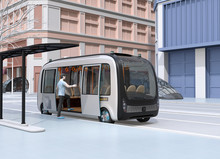 In A Bus Stop A Man Get On A Autonomous Bus. The Bus Stop Equipped With Solar Panels. 3D Rendering Image.