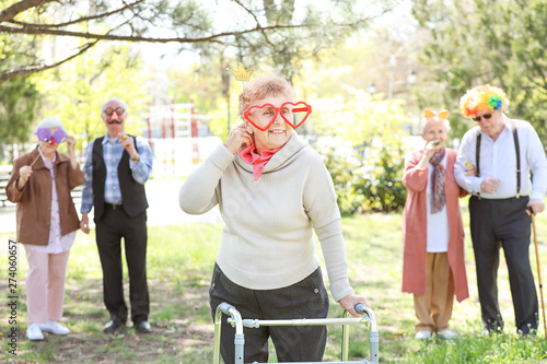 Tableau sur Toile Happy disabled senior woman celebrating Birthday in park