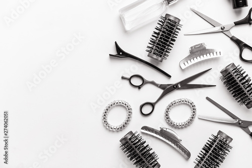 Set of hairdresser tools and accessories on white background