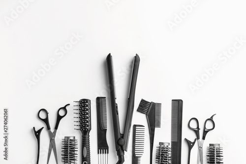 Fotografía  Set of hairdresser tools and accessories on white background
