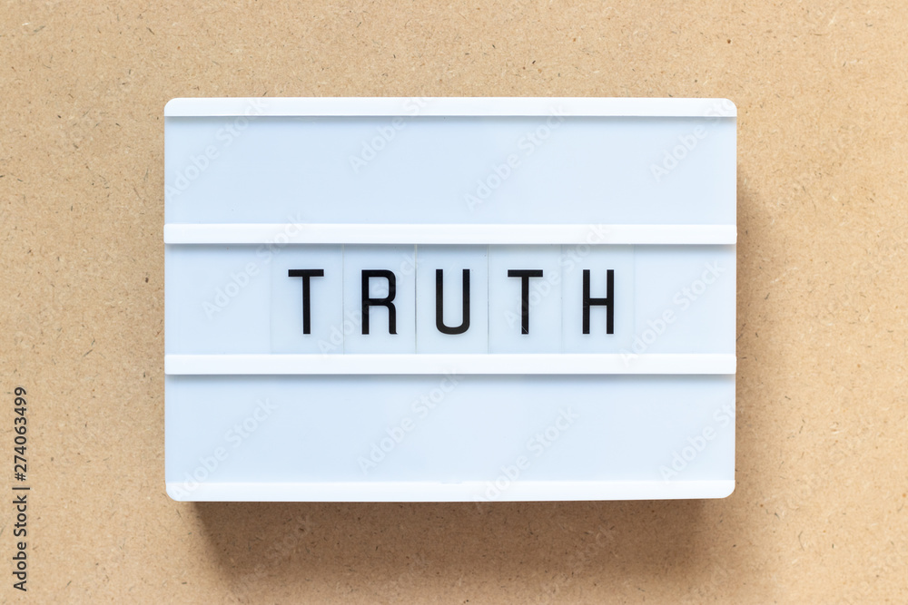 Fototapeta White lightbox with word truth on wood background