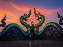 Naga Or Serpent Statue With Sunset  In Wat Khao Phra Kru Temple, Chonburi Province Thailand, The Belief Of Buddhism, Thai Temple.
