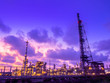 canvas print picture - Oil and gas refinery industrial plant at sunset time.