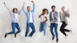 canvas print picture - Happy students jumping on white background, passed exams